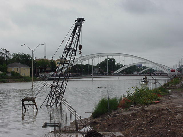 A Houston Freeway flooded - just the top of a tall crane appears above the water.