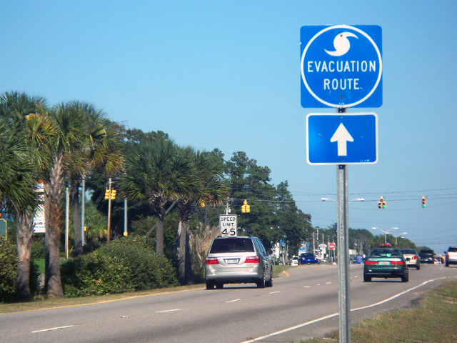 Sign showing way to hurricane evacuation route